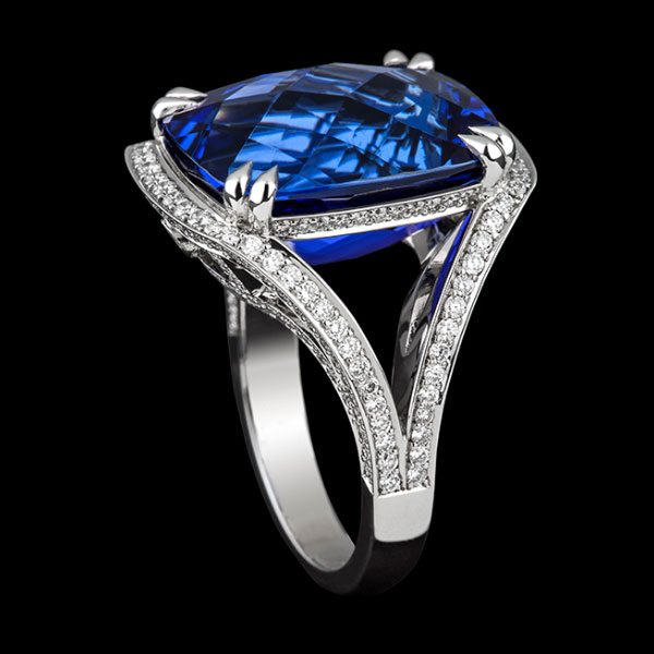 Boutique jewellery Hydra blue sapphire double four claw setting surrounded diamonds